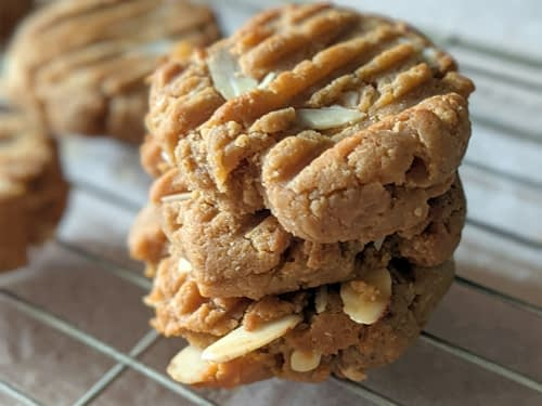 stack of gluten free peanut butter cookies on wire baking rack